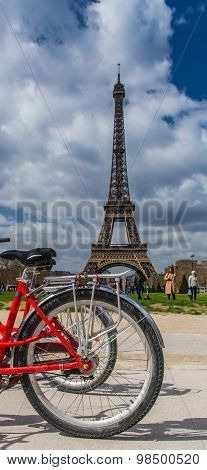Rear Red Bicycle Wheel Over Eiffel Tower On Background In Paris France