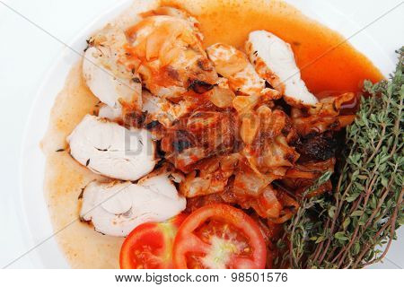 meat grilled chicken fillet with salad and tomatoes on white plate isolated over white background
