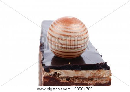 single chocolate cake with sphere isolated over white background
