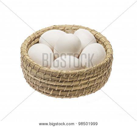 white chicken eggs in wicker basket