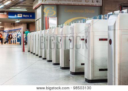 Train station entrance turnstiles in Madrid, Atocha.