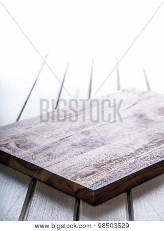 Wooden kitchen utensils on the board. Empty wooden board on the table.