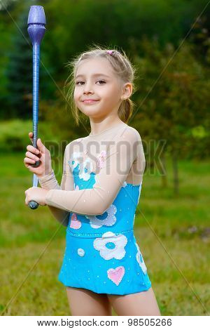 fitness, sport, people and healthcare concept - little sporty girl exercising with gymnastic mace ov