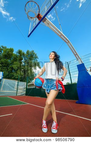 Rapper attitude rap singer hip Hop Dancer performing. Stylish woman posing at basketball court