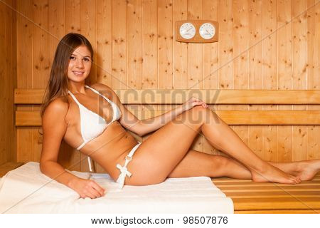 Woman having a steam bath in a sauna