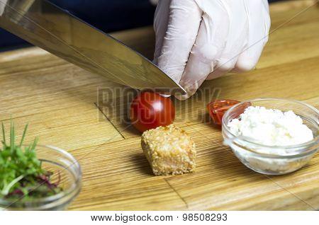 cook prepares canapes