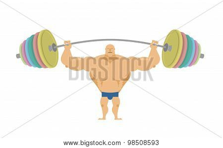 Bodybuilder Raises Sports Barbell With Colored Discs. Bench Press Barbell Standing. Strong Man With