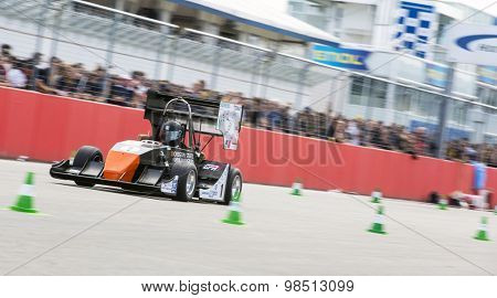 HOCKENHEIM, GERMANY - AUGUST 1, 2015: The Global Formula Student combustion powered car at full speed during the accelleration of the design competition of Formula Student Germany