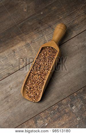 measuring scoop with buckwheat