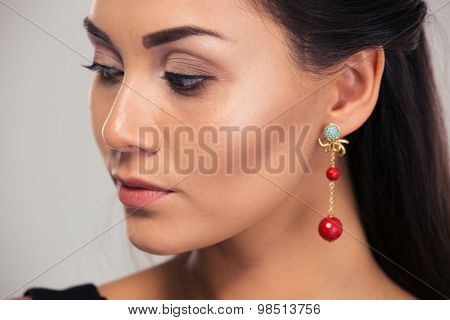 Jewerly concept. Portrait of a beautiful female model looking away