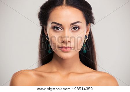 Portrait of attractive cute woman looking at camera isolated on a white background