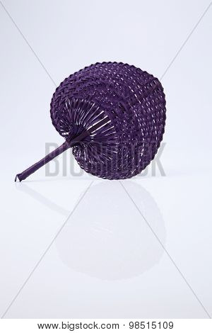 native fan made from palm leaves on white background