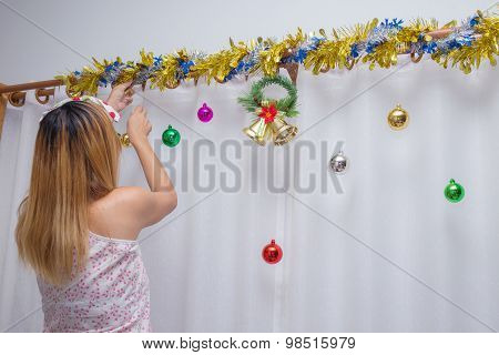 Woman Decorate Christmas In Home