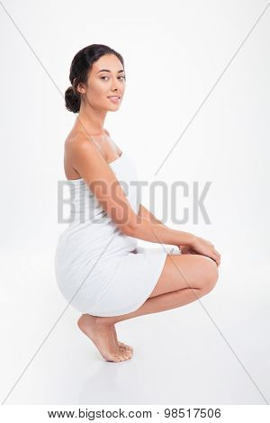 Portrait of a beautiful woman in towel isolated on a white background