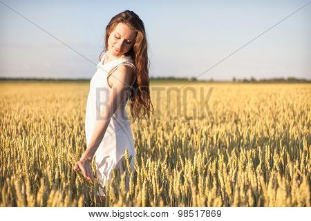 Girl Touching Wheat.