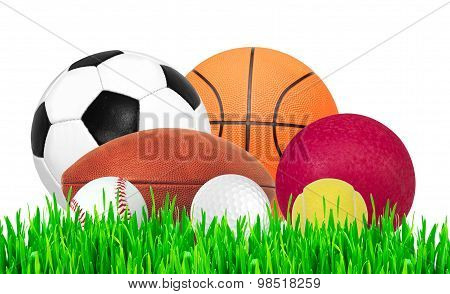 Sport Balls On Green Grass Isolated On White