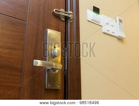 Metal Door Handle On Wooden Door