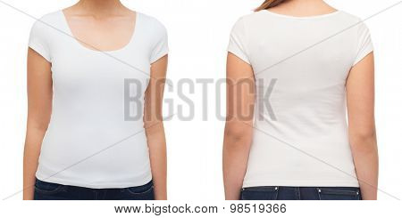 t-shirt design and people concept - close up of young woman in blank white t-shirt