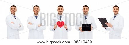 medicine, profession, cardiology and health care concept - happy doctors with red heart, tablet pc and clipboard