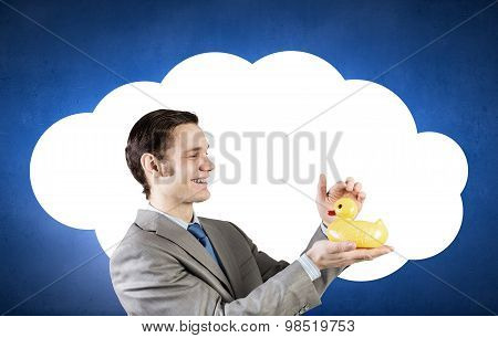 Businessman with duck