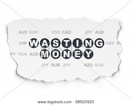 Banking concept: Wasting Money on Torn Paper background