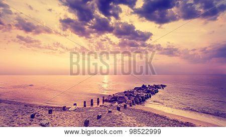 Vintage Filtered Beautiful Purple Sunset Over Beach.