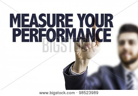 Business man pointing the text: Measure Your Performance