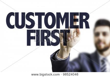 Business man pointing the text: Customer First