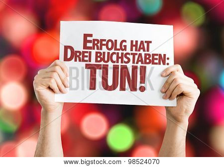 Success Has Three Letters: Do (in German) card with bokeh background