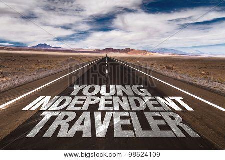 Young Independent Traveler written on desert road