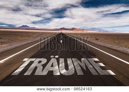 Dreams (in German) written on desert road