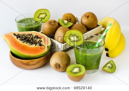 Green Tropical Smoothie With Kiwi, Papaya And Bananas White Background