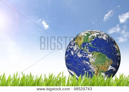 Planet Earth On Beautiful Green Grass