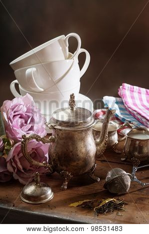 Tea Pot With Dry Tea And Dishware