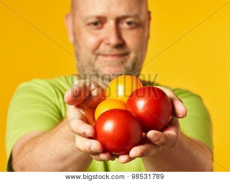 Middle-aged Man And Fresh Ripe Tomatoes