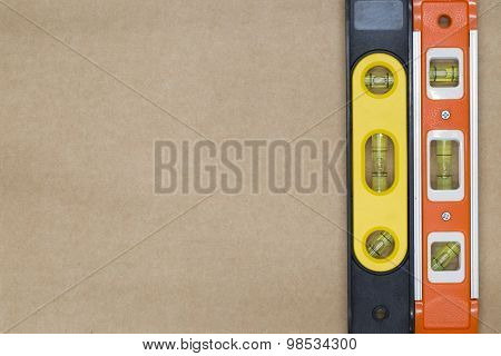 Red And Yellow Building Level On The Brown Paper Background