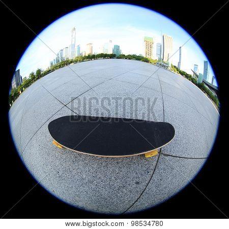 closeup of skateboard on cityshot on fisheye