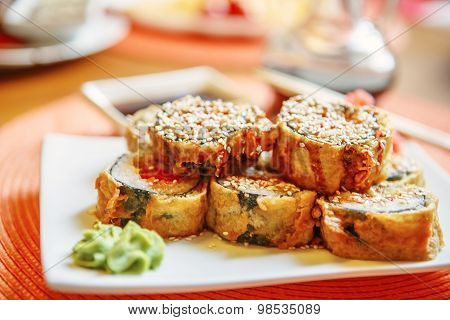 Tempura Maki Sushi (deep Fried Roll Made Of Smoked Eel, Crab Meat And Cream Cheese Inside) With Spic