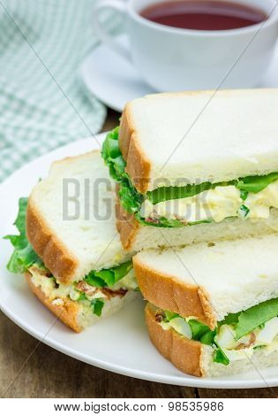 Sandwich With Egg Salad, Bacon, Green Onion And Lettuce