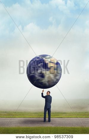 Businessman Holding Planet Earth With One Finger
