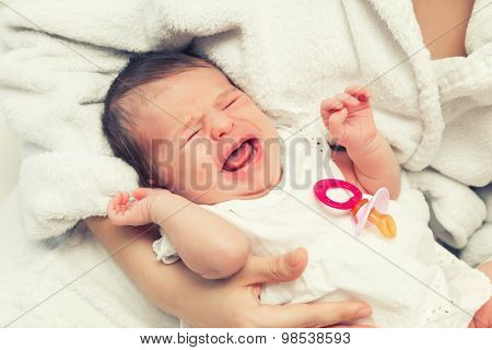 Close up image of crying newborn baby