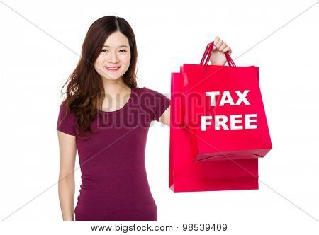 Woman show with shopping bag and showing tax free