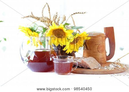 Kvass (kvas) In A Wooden Mug, Bread And A Bouquet Of Sunflowers