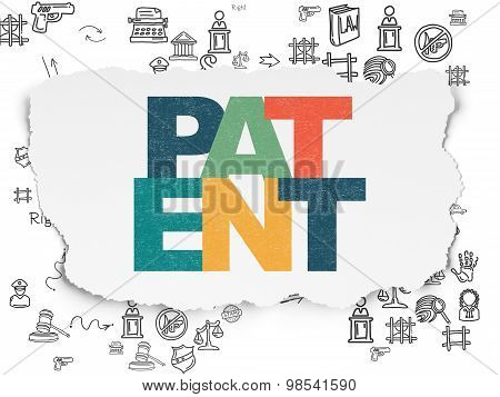 Law concept: Patent on Torn Paper background