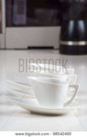 Three Coffee Cups With Coffee Machine And Mill
