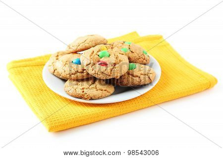 Cookies With Colorful Candy On Plate Isolated On White