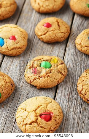 Cookies With Colorful Candy On Grey Wooden Background