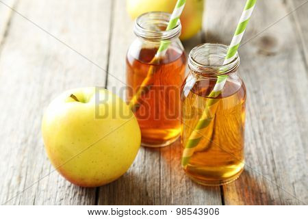Bottle Of Apple Juice On Grey Wooden Background