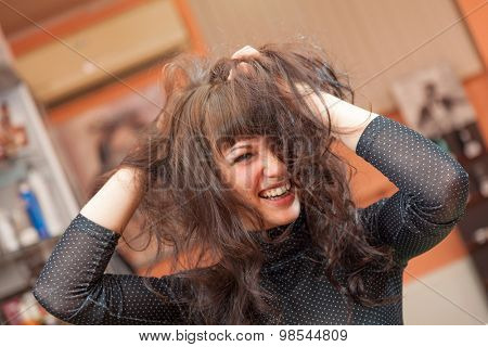 attractive girl with wild hair fun in the interior. portrait