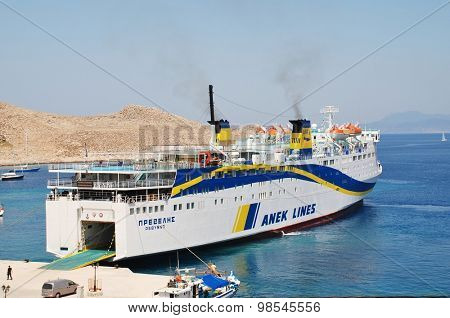 HALKI, GREECE - JUNE 16, 2015: ANEK Lines ferry Prevelis docked at Emborio harbour on the Greek island of Halki. The 142.5mtr ship was built in Japan in 1980 and refitted in 1994.